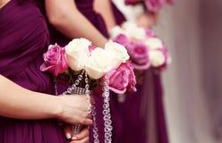 Fileira das mulheres com flores Imagem de Stock Royalty Free