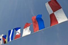 Fileira de bandeiras coloridas Fotografia de Stock