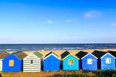 Fileira de cabanas da praia na praia de Southwold Foto de Stock Royalty Free