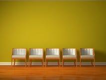 Fileira de cinco cadeiras Imagem de Stock Royalty Free