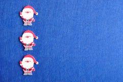 Fileira de cláusulas de Santa fotos de stock