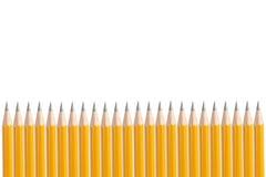Fileira de lápis amarelos Fotografia de Stock Royalty Free