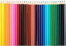 Fileira de lápis coloridos no branco Imagem de Stock