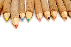 Fileira de lápis rústicos Fotografia de Stock