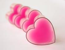 Fileira Defocused de corações cor-de-rosa imagem de stock