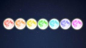 A fileira do arco-íris coloriu Luas cheias no fundo estrelado do céu Imagem de Stock