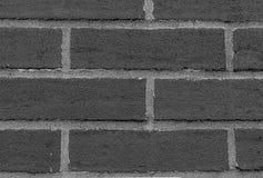 Fileira do cinza monocromático dos tijolos retangulares das pedras com linhas horizontais efeito escuro do cimento do sepia do fu fotografia de stock royalty free