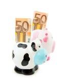Fileira do dinheiro - bancos Piggy Imagens de Stock