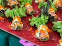Fileira do sushi na placa Imagens de Stock Royalty Free