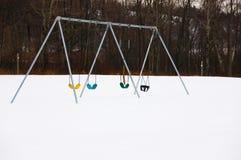 Fileira dos balanços em um dia de inverno Fotografia de Stock Royalty Free