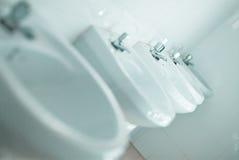 Fileira dos faucets Fotografia de Stock Royalty Free