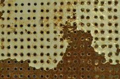 Fileira dos furos na placa do ferro Foto de Stock