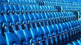Fileiras plásticas azuis dos assentos Imagem de Stock
