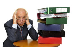 Files. Desperate mature worker with stack of files isolated in white Stock Image