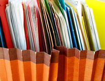 Files. Row of folders in expending file pockets Stock Image