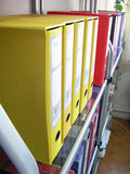 Files. Yellow files on glass shelf in the office Stock Photos