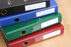 Files. Four colors files on table - office work Stock Images