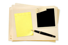 Files with Blank Photo Notepaper and Pen. Stack of manila file folders, with blank vintage photo paperclipped, with yellow notepaper and fountain pen Royalty Free Stock Photos