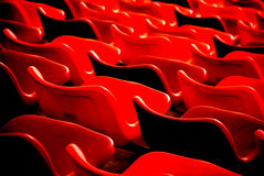 Files of chairs. In a stadium form red parallel curves, concentrating lines and waves Royalty Free Stock Images