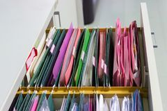 Files document of hanging file folders in a drawer in a whole pile of full papers Royalty Free Stock Images