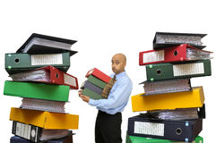 Files everywhere. Businessman with a big pile of files isolated in white Stock Photo