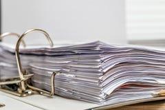 Files folder on office desk. Files folder whithe white papaer on white office desk stock photos