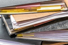 Files folder with papaer on office desk. Files folder with white papaer on white office desk royalty free stock photography