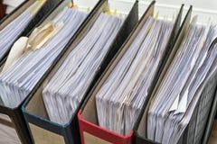 Files folder white office desk. Files folder with white papaer on white office desk stock photos