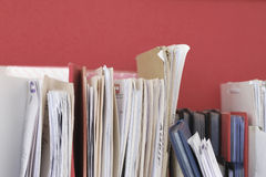 Files In Folders. Files in vertically-arranged folders against maroon background Stock Photography