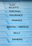 Files Insurance Finance. Files with insurance, receipts, finance, bills, personal, and banking on the tabs Stock Photography