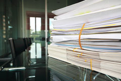 Files on meeting room desk Stock Photos