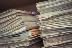 Files in old folder. Stacking up in a messy order. , process in vintage style Royalty Free Stock Images