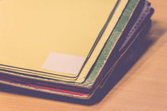 Files in old folder. Stacking up in a messy order. , process in vintage style Royalty Free Stock Image