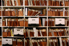 Files on Shelf. Office shelves full of files and boxes Royalty Free Stock Photo