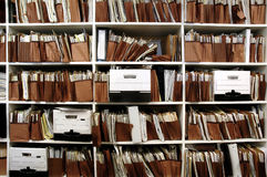 Files on Shelf. Office shelves full of files and boxes Royalty Free Stock Photography