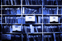 Files on Shelf. Office shelves full of files and boxes Royalty Free Stock Images