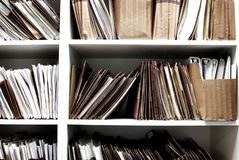 Files on Shelf Organized for Office Work stock photo