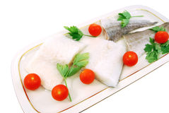 Filet of cod with tomatoes and parsley Royalty Free Stock Photography