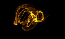 Filet coloré d'énergie de la lumière sur le fond noir illustration stock