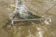 Filet de pêche dans l'action Photographie stock libre de droits