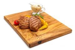 Filet de porc grillé avec la sauce aux champignons crémeuse Photos stock