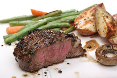 Filet dinner with mushrooms Stock Images