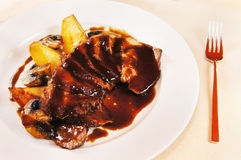 Filet of a duck with glazed pears Royalty Free Stock Photography