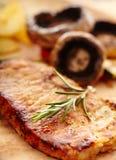 Filet frit et champignons grillés Photographie stock