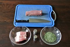 Filet with herbs in bacon coat - SERIES - Image 1 of 8 Stock Images