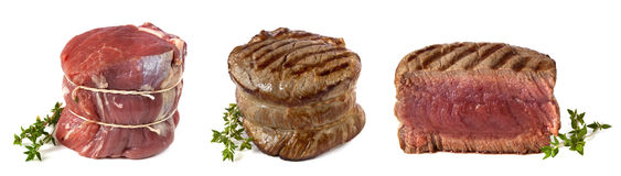 Filet Mignon. Three views of a filet mignon - uncooked, char-grilled, and cut ready to enjoy.  Perfect medium rare, garnished with thyme Stock Image