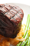 Filet Mignon. Thick Filet mignon served with crispy onions and asparagus Stock Image