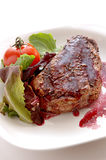 Filet mignon. Pepper-crusted filet mignon with red wine sauce Stock Images