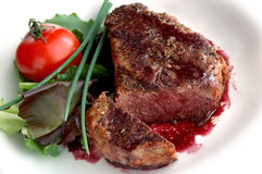 Filet mignon. Pepper-crusted filet mignon with red wine sauce Stock Photos