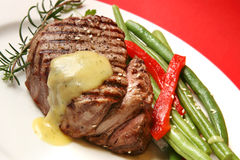 Filet Mignon. With bearnaise sauce, green beens, red bell pepper, sesame seeds and rosemary Royalty Free Stock Image